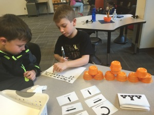 Coding Unplugged! Write code to direct someone in various cup stacking patterns.